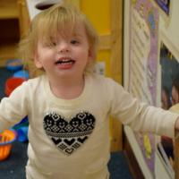 Blonde toddler girl in child care setting