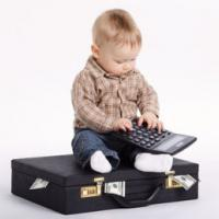 Baby bookkeeper with suitcase of money