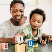 mother and child play with blocks